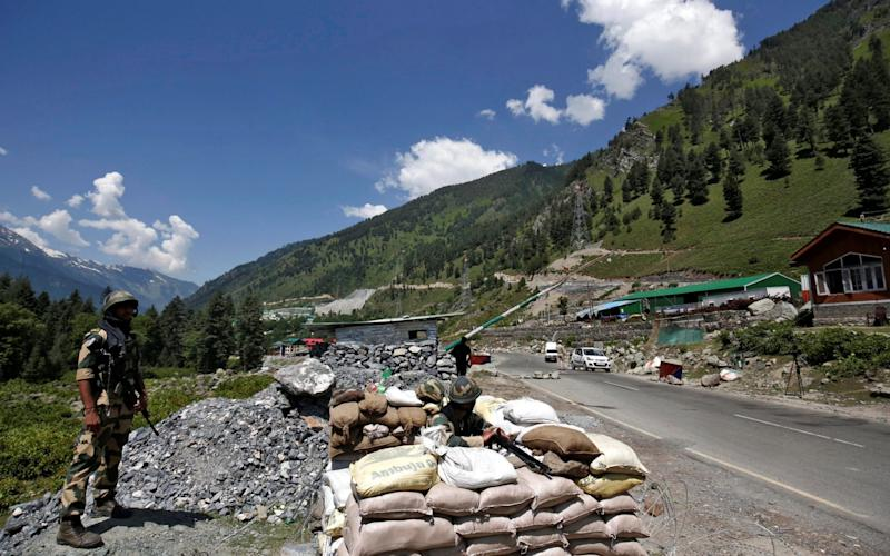 India's BSF soldiers stand guard at a checkpoint along a highway leading to Ladakah - REUTERS