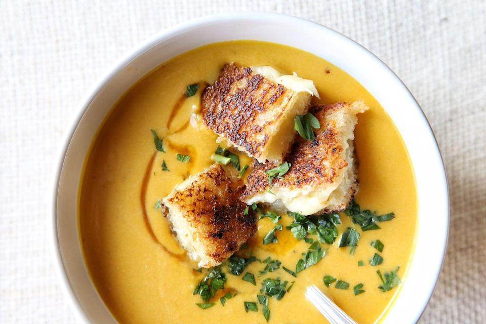 """<p>Comfort food at its finest!</p><p>Get the recipe from <a href=""""https://www.delish.com/cooking/recipe-ideas/recipes/a49770/creamy-pumpkin-soup-with-grilled-cheese-croutons-recipe/"""" rel=""""nofollow noopener"""" target=""""_blank"""" data-ylk=""""slk:Delish"""" class=""""link rapid-noclick-resp"""">Delish</a>.</p>"""