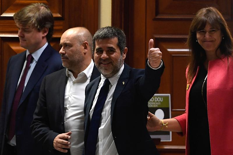 Jailed Catalan separatist and elected member of parliament Jordi Sanchez (C) was one of those released to be allowed to register as a lawmaker