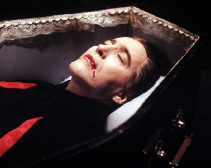 Christopher Lee, British actor, blood trickling from his mouth as lays in a coffin in a publicity still issued for the film, 'Dracula', 1958. The Hammer horror film, directed by Terence Fisher (1904-1980), starred Lee as 'Count Dracula'. (Photo by Silver Screen Collection/Getty Images)