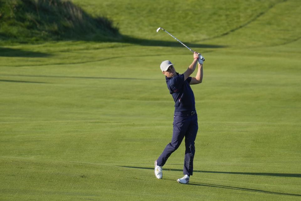 Team USA's Justin Thomas hits on the fifth hole during a foursome match the Ryder Cup at the Whistling Straits Golf Course Friday, Sept. 24, 2021, in Sheboygan, Wis. (AP Photo/Ashley Landis)