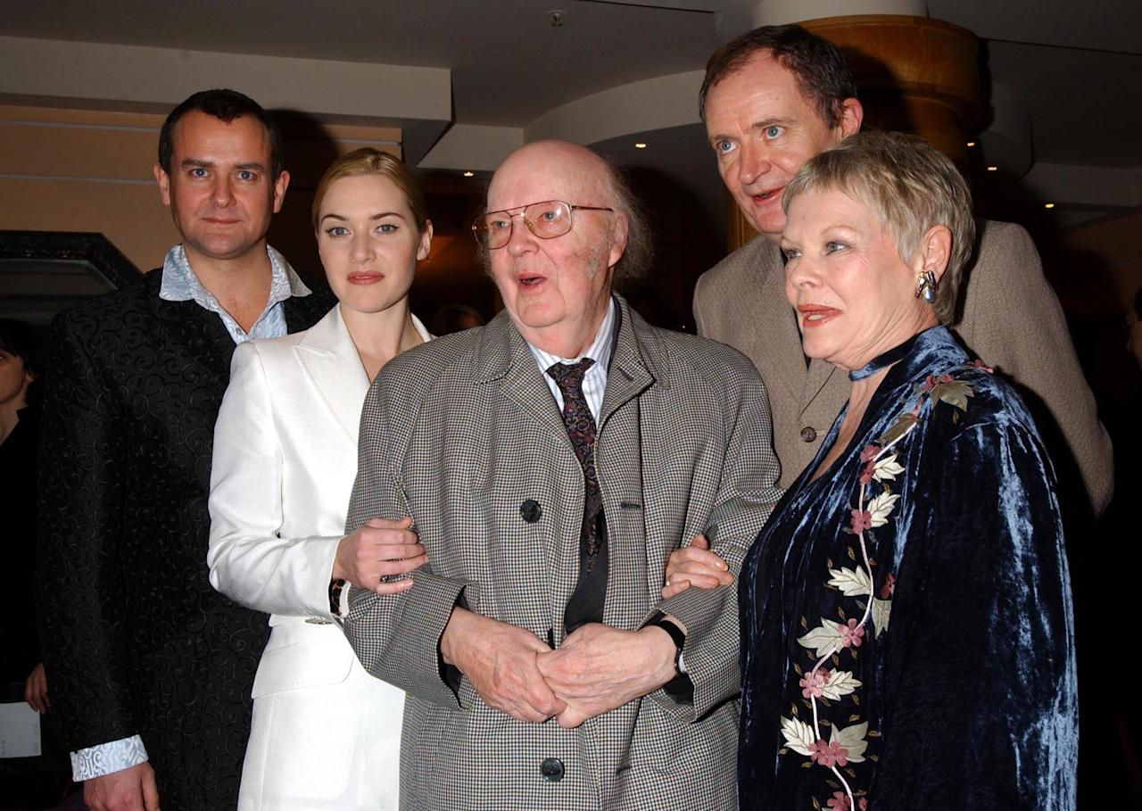 John Bayley (C) husband of the late Dame Iris Murdoch, with stars of the film, (L-R) Hugh Bonneville, Kate Winslet, Jim Broadbent and Dame Judi Dench during a press reception at the Washington Hotel in central London, ahead of the premiere of 'Iris' at the Curzon Mayfair.  * The film follows the story of Booker Prize-winning novelist and philosopher Iris Murdoch who died in 1999, played by Kate Winslet and Judi Dench.   (Photo by Yui Mok - PA Images/PA Images via Getty Images)