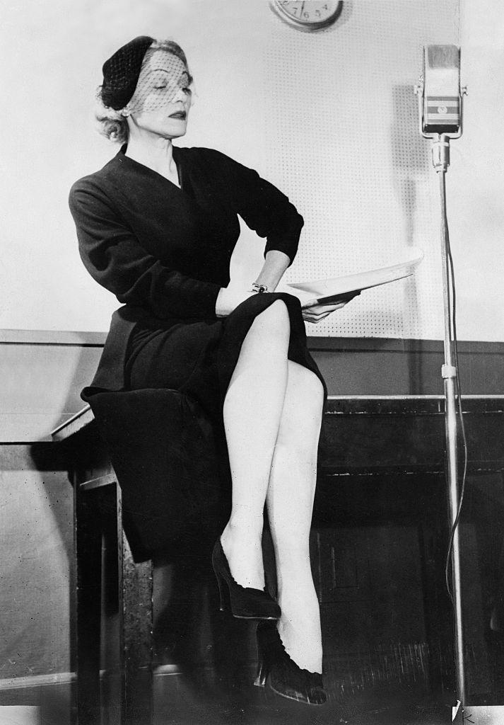 <p>The Berlin-born icon, who eventually lived the latter years of her life in Paris, wears her go-to black suit and netted fascinator while recording for a radio show in New York City. <br></p>