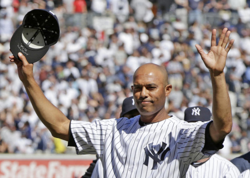 New York Yankees relief pitcher Mariano Rivera (42) acknowledges the crowd as he is honored during a pregame ceremony at Yankee Stadium before a baseball game against the San Francisco Giants, Sunday, Sept. 22, 2013, in New York. The 13-time All-Star closer is retiring at the end of this season. (AP Photo/Kathy Willens)