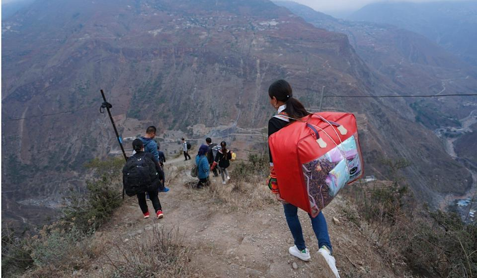Rural families walk to their new homes in Zhaojue county, southwest China's Sichuan province. Photo: Xinhua