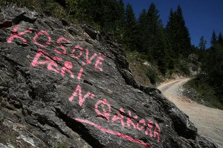 """A graffiti, which reads: """"Kosovo to Qakorr"""" (regarding demarcation of the border with Montenegro), is pictured at a crossroad in the village of Haxaj, Peja, in Kosovo, near the border with Montenegro, August 28, 2016. REUTERS/Hazir Reka"""