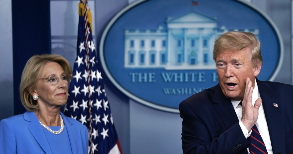 U.S. President Donald Trump speaks as Secretary of Education Betsy DeVos and Secretary of Agriculture Sonny Perdue look on during a briefing on the coronavirus pandemic in the press briefing room of the White House on March 27, 2020 in Washington, DC. (Photo: Drew Angerer/Getty Images)