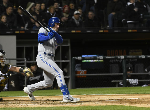 Toronto Blue Jays' Billy McKinney (28) follows through on a two-run double off of Chicago White Sox starting pitcher Ivan Nova during the third inning of a baseball game Friday, May 17, 2019, in Chicago. (AP Photo/Matt Marton)