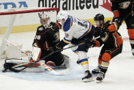 St. Louis Blues' Zach Michael Sanford, center, gets his shot stopped by Anaheim Ducks goaltender John Gibson while defended by Ducks' Kevin Shattenkirk, right, during the first period of an NHL hockey game Saturday, Jan. 30, 2021, in Anaheim, Calif. (AP Photo/Jae C. Hong)