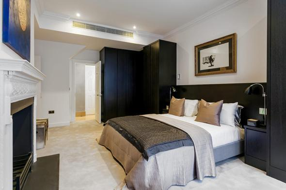 Pictured is a mock up of what a typical room would look like at the former Great Scotland building in Whitehall which is to be turned into a hotel.  The site of the first Met Police station where officers hunted Jack the Ripper is to be transformed into a five-star hotel with GBP10,000-A-NIGHT rooms.  See SWNS story SWPOLICE.  Great Scotland Yard in Whitehall was the headquarters of London?s newly formed police force from 1829 to 1890.   Officers investigated Jack the Ripper and the Plaistow murders from the base while Charles Dickens and Arthur Conan Doyle would regularly write about the top cop shop.  It later became a library for the Ministry of Defence but it was revealed yesterday (Sun) the Crown estate had struck a deal with a property developer to turn it into a super-posh hotel.   The Galliard Group has acquired a 125 year lease on the seven-storey building and plan to turn it into a GBP100 million hotel with 235 bedrooms and suites.  It will boast a grand entrance foyer, winter garden lounge, signature restaurant, cocktail bar and lounge, second lounge, library, 120 seater main conference room/ballroom, meeting rooms and function/private dining rooms.   There will also be special super-VIP suites for the richest of the rich - with the rooms costing a whopping GBP10,000 a night and putting them amongst the most expensive in the world.