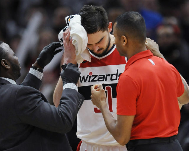 Wizards' Tomas Satoransky is tended to after being injured when fouled by Bulls' Bobby Portis during the final minutes of an NBA basketball game Saturday, Feb. 10, 2018, in Chicago. (AP)