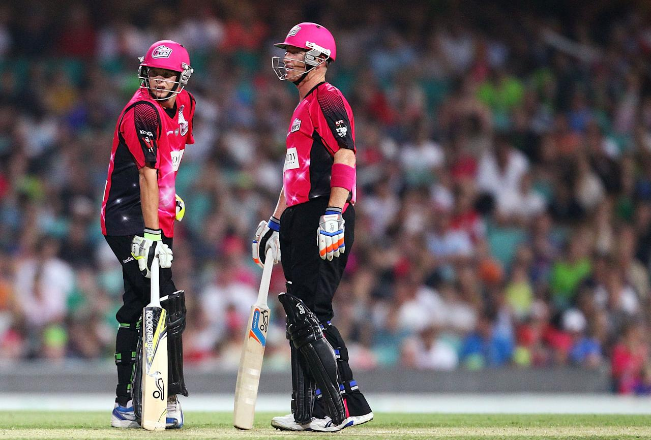 SYDNEY, AUSTRALIA - DECEMBER 08: Steven Smith and Brad Haddin of the Sixers chat mid wicket during the Big Bash League match between the Sydney Sixers and the Sydney Thunder at Sydney Cricket Ground on December 8, 2012 in Sydney, Australia.  (Photo by Mark Nolan/Getty Images)