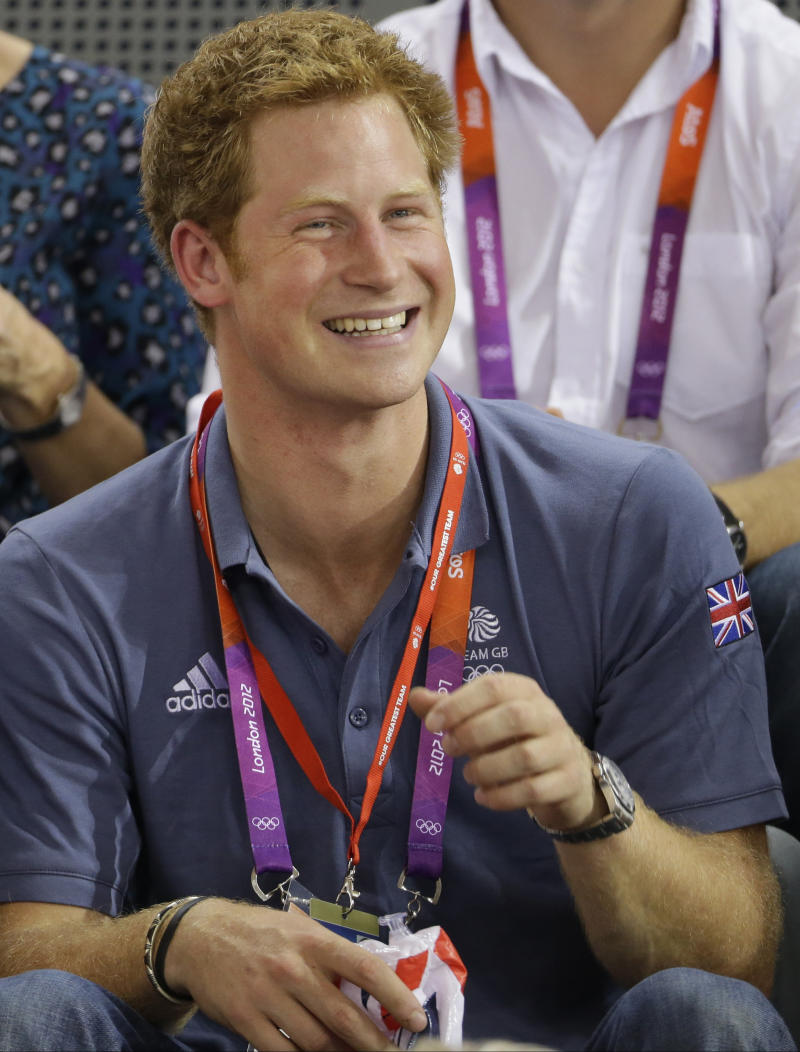 FILE- Britain's Prince Harry watches track cycling during the 2012 Summer Olympics, in this file photo dated Thursday, Aug. 2, 2012, in London.  Nude photographs of Prince Harry in a Las Vegas, USA, hotel room are published on the Internet Wednesday Aug. 22, 2012,  and now security experts are wondering whether the Scotland Yard officers who are assigned to keep the 27-year-old royal safe from harm, might have done a better job of keeping him out of trouble. The photos available on the Internet and not taken by Photographers' long lenses but are up close and personal. (AP Photo/Matt Rourke, File)