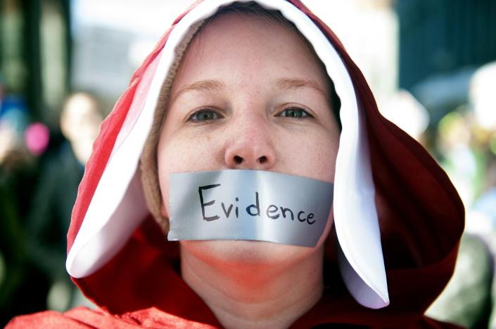 Sabrina Saunders of Littleton, Colo., dressed in an outfit from The Handmaid's Tale, marches during the Women's March in Denver, Colorado on Jan. 19, 2019. (Photo: Jason Connolly/AFP/Getty Images)