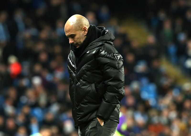 MANCHESTER, ENGLAND - DECEMBER 07: Manager Pep Guardiola of Manchester City walks off after the Premier League match between Manchester City and Manchester United at Etihad Stadium on December 07, 2019 in Manchester, United Kingdom. (Photo by John Peters/Manchester United via Getty Images)