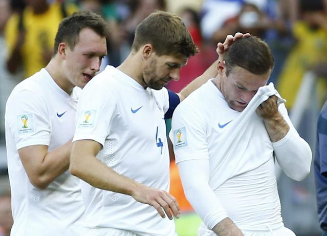England's Phil Jones ,Steven Gerrard and Wayne Rooney react after the match against Costa Rica during their 2014 World Cup Group D soccer match at the Mineirao stadium in Belo Horizonte June 24, 2014. REUTERS/Murad Sezer (BRAZIL - Tags: SOCCER SPORT WORLD CUP TPX IMAGES OF THE DAY) TOPCUP