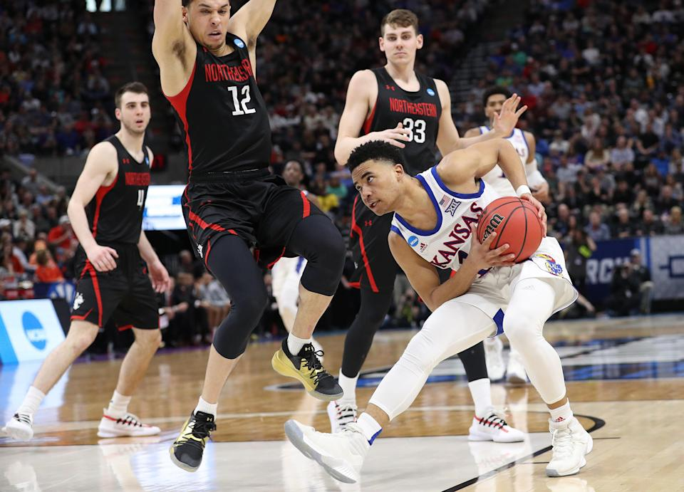 <p>Devon Dotson #11 of the Kansas Jayhawks handles the ball against Jordan Roland #12 of the Northeastern Huskies during the second half in the first round of the 2019 NCAA Men's Basketball Tournament at Vivint Smart Home Arena on March 21, 2019 in Salt Lake City, Utah. </p>
