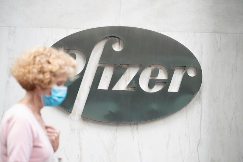 Photo by: John Nacion/STAR MAX/IPx 2020 A view of people passing by Pfizer logo at their New York Headquarters on September 14, 2020. Pfizer coronavirus vaccine could be given to Americans before end of the year, CEO says. (Photo: John Nacion/STAR MAX/IPx)
