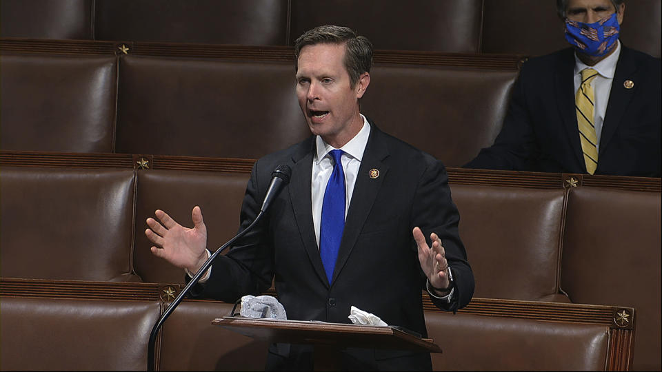 """FILE - In this April 23, 2020, file image from video, Rep. Rodney Davis, R-Ill., speaks on the floor of the House of Representatives at the U.S. Capitol in Washington. The mood is so bad at the Capitol that a Democratic congressman recently let an elevator pass him by rather than ride with Republican colleagues who voted against certifying Joe Biden's election. """"The mood is toxic,"""" said Davis, """"I mean, it really sucks to be in the minority, but it's really worse when there's just such a high partisan temperature."""" (House Television via AP, File)"""