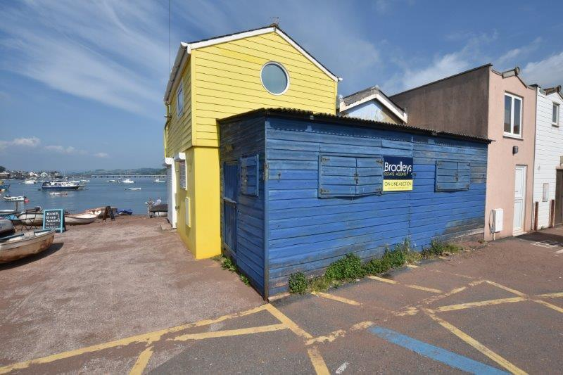 This small blue shed could be yours for upwards of £69K (Image: Bradleys Estate Agents/SWNS)