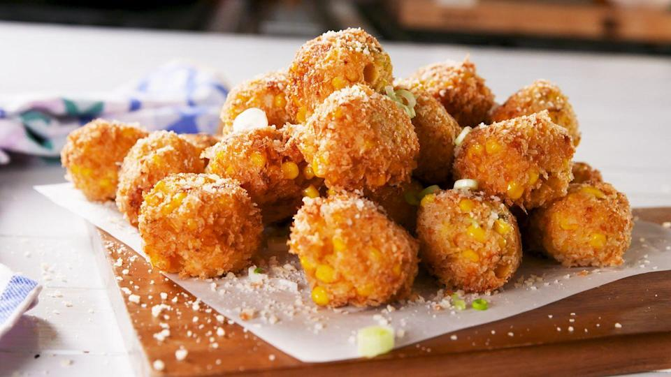 """<p>Crunchy, cheesy...you can't go wrong.</p><p>Get the recipe from <a href=""""https://www.delish.com/cooking/recipe-ideas/a22228547/cheesy-corn-poppers-recipe/"""" rel=""""nofollow noopener"""" target=""""_blank"""" data-ylk=""""slk:Delish"""" class=""""link rapid-noclick-resp"""">Delish</a>.</p>"""