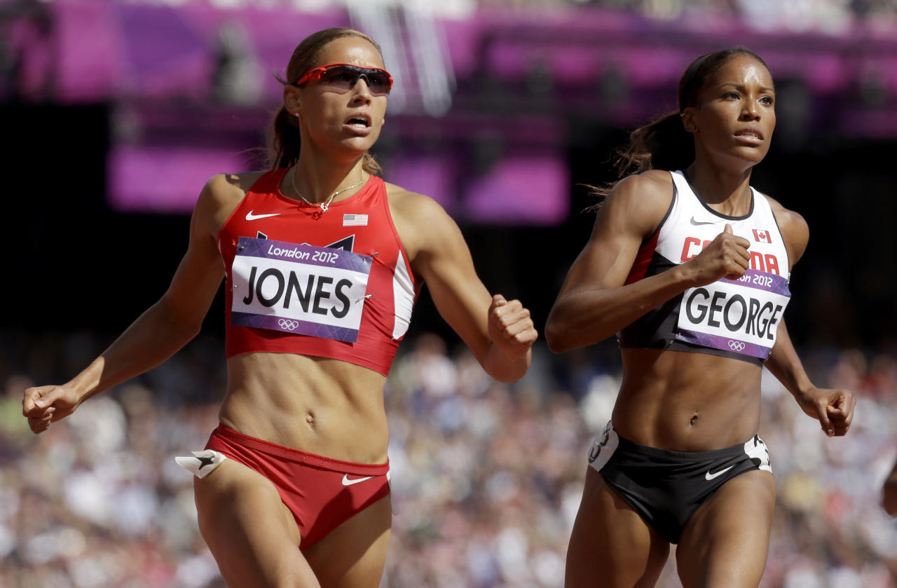 United States' Lolo Jones, left, and Canada's Phylicia George compete in a women's 100-meter hurdles heat during the athletics in the Olympic Stadium at the 2012 Summer Olympics, London, Monday, Aug. 6, 2012. (AP Photo/Anja Niedringhaus)