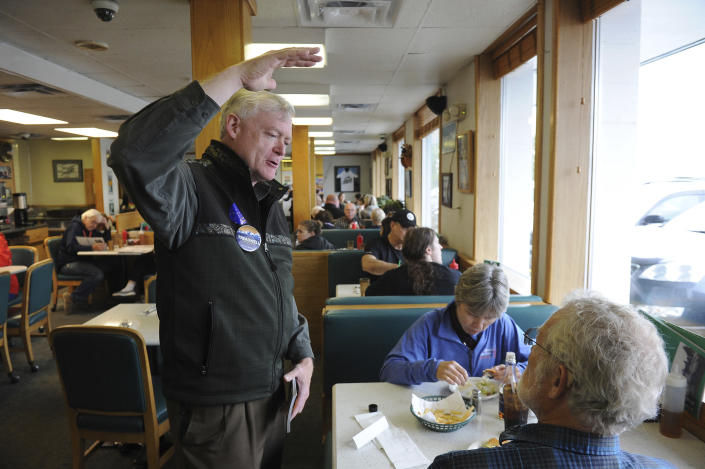Republican gubernatorial candidate Mead Treadwell engages diners at a restaurant Tuesday, Aug. 21, 2018, in Anchorage, Alaska. Treadwell, a former Alaska lieutenant governor, is one of seven Republicans vying in the Alaska Primary. The winner advances to the general election and is expected to face incumbent Gov. Bill Walker, an independent, and former U.S. Sen. Mark Begich, a Democrat. (AP Photo/Michael Dinneen)