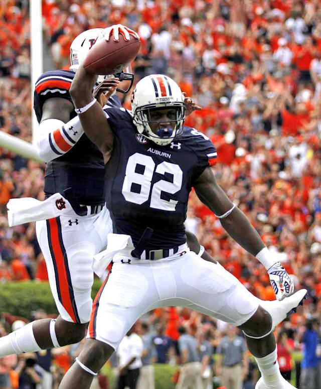 Auburn wide receiver Melvin Ray (82) celebrates with quarterback Jeremy Johnson (6) after he scored a touchdown against Arkansas during the first half of an NCAA college football game on Saturday, Aug. 30, 2014, in Auburn, Ala. (AP Photo/Butch Dill)