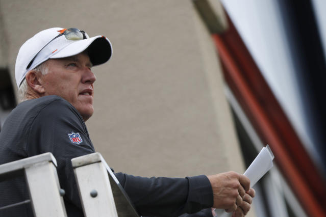 Denver Broncos general manager John Elway looks on during an NFL football training camp with the Broncos and San Francisco 49ers Friday, Aug. 16, 2019, in Englewood, Colo. (AP Photo/David Zalubowski)