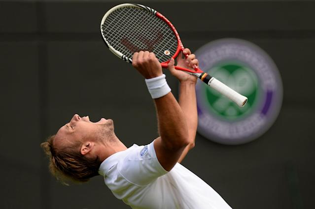LONDON, ENGLAND - JUNE 24: Steve Darcis of Belgium celebrates match point during his Gentlemen's Singles first round match against Rafael Nadal of Spain on day one of the Wimbledon Lawn Tennis Championships at the All England Lawn Tennis and Croquet Club on June 24, 2013 in London, England. (Photo by Mike Hewitt/Getty Images)