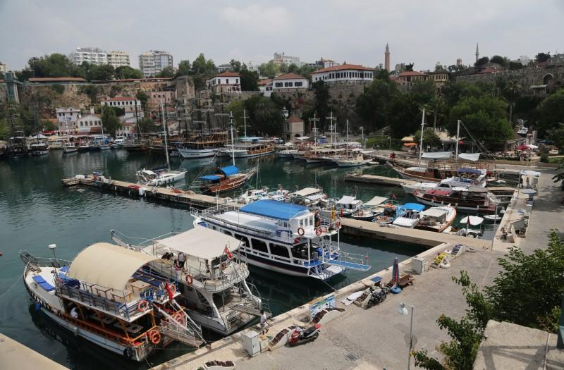 FILE PHOTO: Tourists boats are seen in the harbour of the old city center of the Mediterranean resort city of Antalya