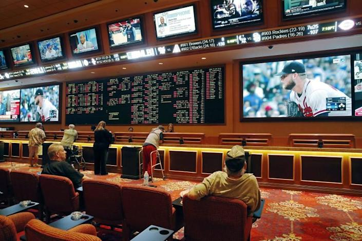 "People make bets in the sports book at the South Point hotel and casino in Las Vegas in 2018. <span class=""copyright"">(John Locher / Associated Press)</span>"
