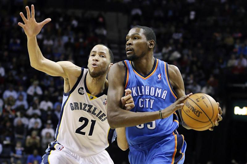 Oklahoma City Thunder's Kevin Durant, right, is guarded by Memphis Grizzlies' Tayshaun Prince (21) during the first half of an NBA basketball game in Memphis, Tenn., Wednesday, March 20, 2013. (AP Photo/Danny Johnston)