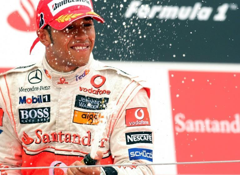 Home joy: Hamilton celebrates victory at the British Grand Prix at Silverstone in 2008