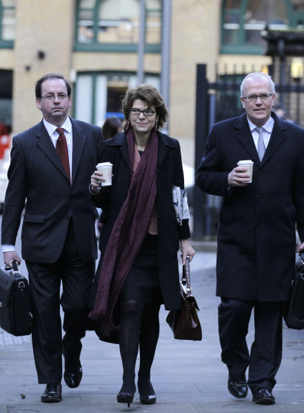 Vicky Pryce, centre, ex-wife of former Energy Secretary Chris Huhne arrives at Southwark Crown Court in London for her trial hearing accused of perverting the course of justice, Monday, Feb. 4, 2013. Former government Energy Secretary Chris Huhne and his ex-wife Vicky Pryce appear in court to face charges of perverting the course of justice relating to Huhne allegedly asking his then wife Pryce to take penalty points for a car speeding offence almost a decade ago. Member of Parliament Huhne resigned from the cabinet after the Crown Prosecution Service announced that he and Pryce would face charges. (AP Photo/Sang Tan)