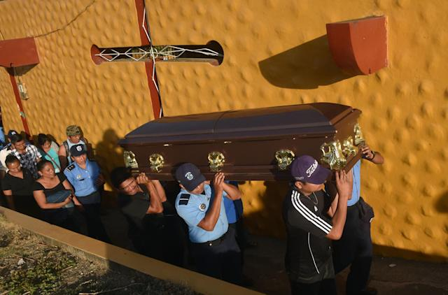 <p>Relatives and colleagues of Nicaragua's policewoman Juana Francisca Aguilar, who died after being injured during clashes in protests against the government of President Daniel Ortega, carry her coffin during her funeral in Jinotepe 50 kilometres south of Managua on April 24, 2018. Nicaragua was sliding into unchartered territory on Tuesday with protests against longtime President Daniel Ortega swelling to outpace a robust police crackdown in which at least 27 people have been killed. Nearly a week of unrest has violently exposed public resentment of the 72-year-old leftist leader and his wife Rosario Murillo, who is the vice president. (Photo: Rodrigo Arangua/AFP/Getty Images) </p>