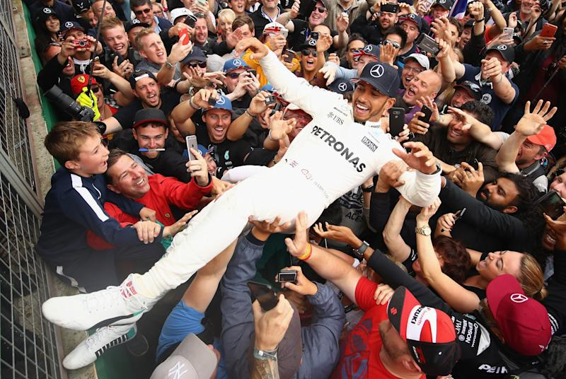 Lewis Hamilton was swept away by fans after winning a fifth British Grand Prix
