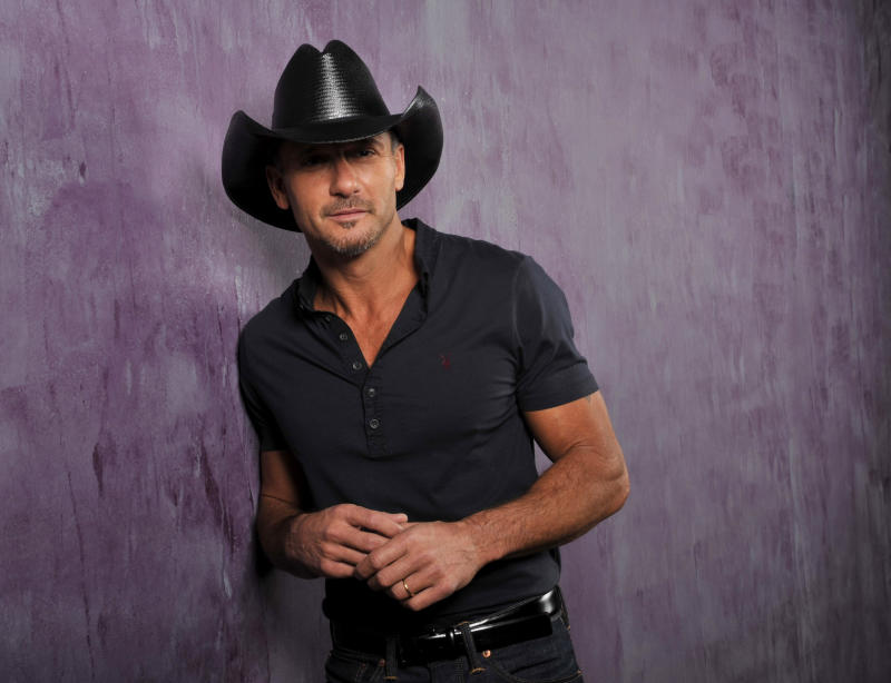 """This Jan. 15, 2013 photo shows country singer and actor Tim McGraw in Nashville, Tenn. His latest album, """"Two Lanes of Freedom,"""" will be released on Tuesday, Feb. 5.  (Photo by Donn Jones/Invision/AP)"""