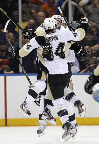Pittsburgh Penguins center Tyler Kennedy celebrates with defenseman Brooks Orpik (44), who scored the winning goal in overtime of Game 6 of a first-round NHL Stanley Cup playoff hockey series against the New York Islanders in Uniondale, N.Y., Saturday, May 11, 2013. The Penguins won 4-3, and advanced to the Eastern Conference semifinals. (AP Photo/Kathy Willens)
