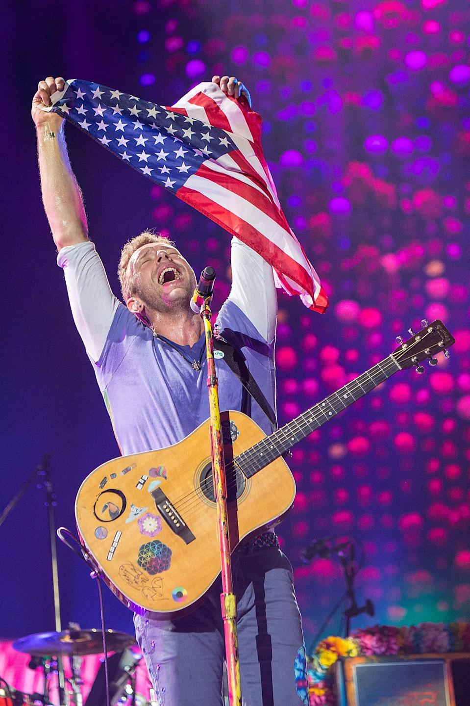 """<p>In San Diego, the Coldplay frontman held up the U.S. flag during a concert. The Friday edition of that same show featured an appearance by late night host James Corden, who joined the band in a rendition of """"Free Fallin"""" by the late Tom Petty, one of many tributes since Petty's Oct. 2 death. (Photo: Daniel Knighton/Getty Images) </p>"""