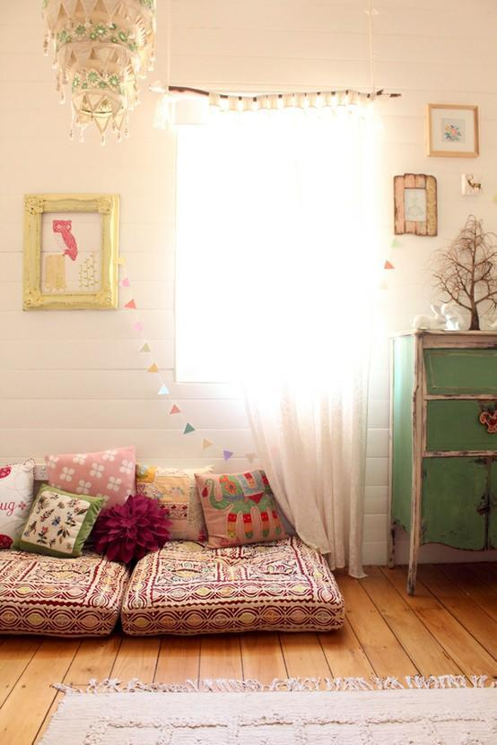 """<div class=""""caption-credit""""> Photo by: Smallesthings</div><div class=""""caption-title"""">Sweet and Simple</div>Set up a reading nook with floor cushions and make it extra personal with touches like bunting and framed pictures. Mood-setting and comfort are the two most important factors in a kid's reading nook. <br> <i><a rel=""""nofollow noopener"""" href=""""http://blogs.babble.com/family-style/2012/08/13/25-cute-and-cozy-kids-reading-nooks/#sweet-and-simple"""" target=""""_blank"""" data-ylk=""""slk:Get the inspiration here"""" class=""""link rapid-noclick-resp"""">Get the inspiration here</a></i> <br> <br> <i><b><a rel=""""nofollow noopener"""" href=""""http://blogs.babble.com/family-style/2012/08/10/21-fabulous-display-ideas-for-kid-art/"""" target=""""_blank"""" data-ylk=""""slk:Related: 21 stylish ways to decorate with your kid's artwork"""" class=""""link rapid-noclick-resp"""">Related: 21 stylish ways to decorate with your kid's artwork</a> <br></b></i>"""