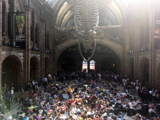 Extinction Rebellion protesters lying down inside the Natural History Museum in London