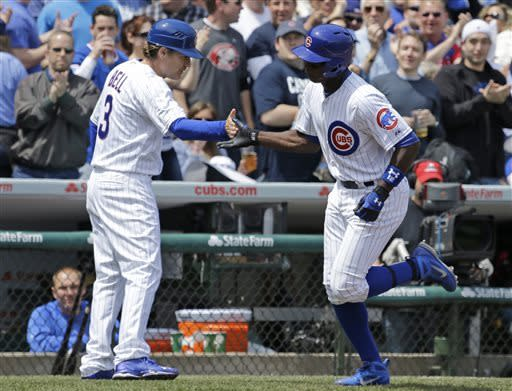 Chicago Cubs' Alfonso Soriano, right, celebrates with third base coach David Bell after hitting a two-run home run during the third inning of a baseball game against the Cincinnati Reds in Chicago, Saturday, May 4, 2013. (AP Photo/Nam Y. Huh)