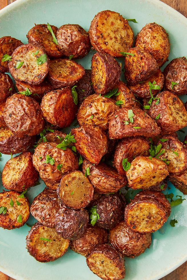 """<p>We pride ourselves for how perfect our <a href=""""https://www.delish.com/uk/cooking/recipes/a28786247/herb-roasted-potatoes/"""" rel=""""nofollow noopener"""" target=""""_blank"""" data-ylk=""""slk:roasted potatoes"""" class=""""link rapid-noclick-resp"""">roasted potatoes</a> are. We truly thought they couldn't get be any better, but it turns out the air fryer works some kind of magic on potatoes. They get extra crispy all over and stay perfectly soft on the inside. Toss them in just a little bit of oil so all of the seasonings stick to make these the most addicting potatoes ever. </p><p>Get the <a href=""""https://www.delish.com/uk/cooking/recipes/a30376680/air-fryer-potatoes-recipe/"""" rel=""""nofollow noopener"""" target=""""_blank"""" data-ylk=""""slk:Air Fryer Potatoes"""" class=""""link rapid-noclick-resp"""">Air Fryer Potatoes</a> recipe.</p>"""