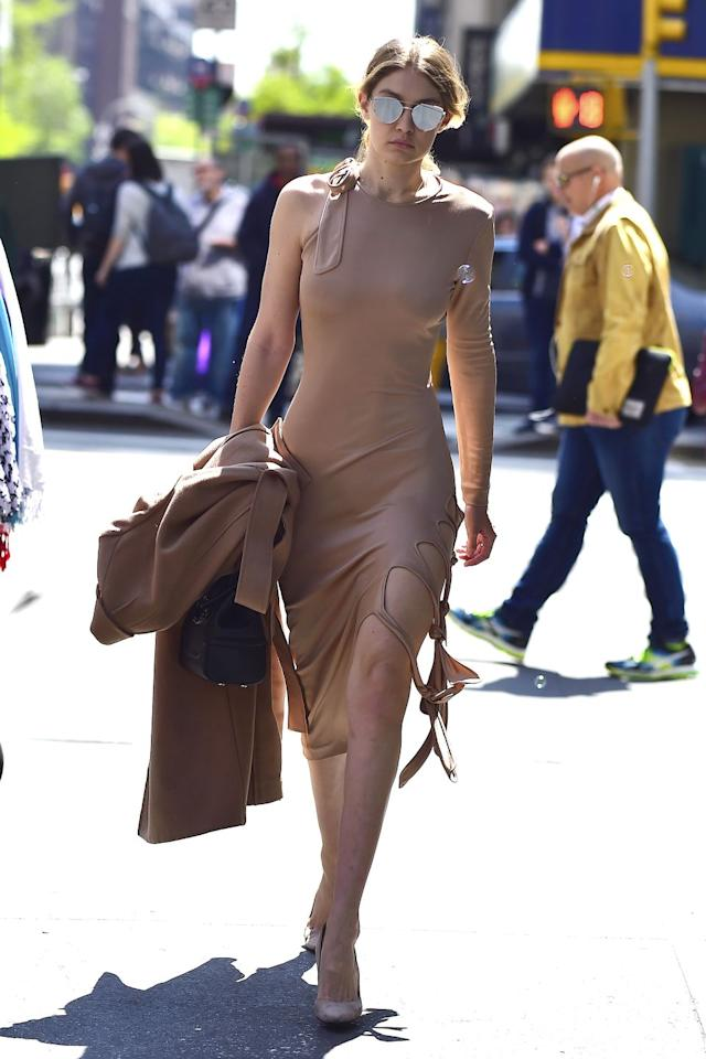 <p>Hadid showed off her curves in nude Jonathan Simkhai dress with cutout details, paired with pumps in a matching hue, a Versace bag and Gentle Monster silver sunnies. </p>