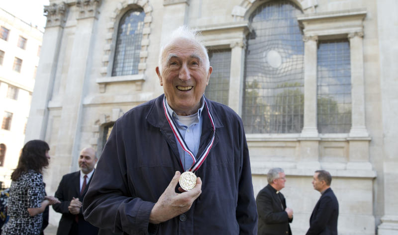 FILE - In this May 18, 2018 file photo, Canadian Jean Vanier founder of L'Arche communities poses for a photograph after he received the Templeton Prize at St Martins-in-the-Fields church in London. Vanier, a Canadian religious figure whose charity work helped improve conditions for the developmentally disabled in multiple countries over the past half-century, has died Tuesday May 7, 2019 in Paris after suffering from thyroid cancer at 90. (AP Photo/Alastair Grant, File)