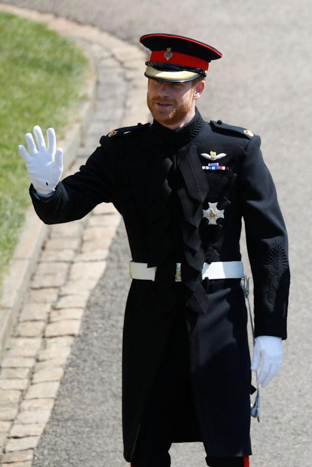 Prince Harry arrives at the royal wedding wearing his military uniform and a beard. (Photo: Getty Images)