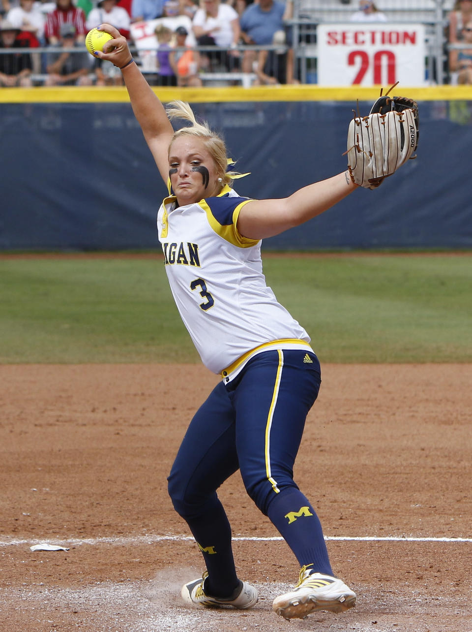 Michigan's Megan Betsa pitches in the second inning during an NCAA Women's College World Series softball game against LSU in Oklahoma City, Sunday, May 31, 2015. Michigan won 6-3 and moves on to the championship series. (AP Photo/Alonzo Adams)