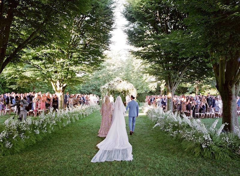As I walked down the aisle to meet my parents, I was overwhelmed with emotion. The love was truly palpable. Lee stood at the end of the chuppah waiting to meet me as the sun glistened over him, creating a natural spotlight.