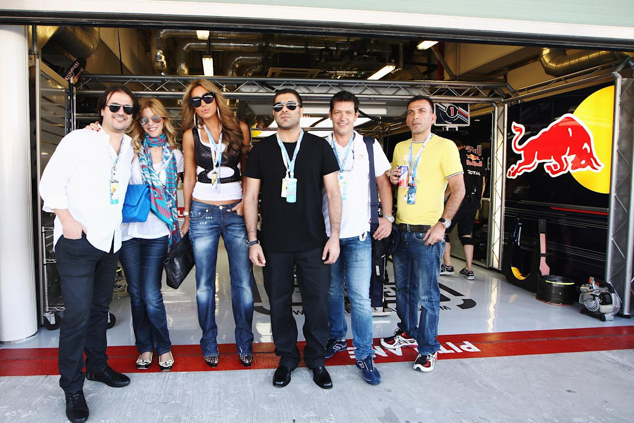 ABU DHABI, UNITED ARAB EMIRATES - NOVEMBER 12:  Lebanese singer Maya Diab (3rd left) visits the Red Bull Racing garage before qualifying for the Abu Dhabi Formula One Grand Prix at the Yas Marina Circuit on November 12, 2011 in Abu Dhabi, United Arab Emirates.  (Photo by Ker Robertson/Getty Images)